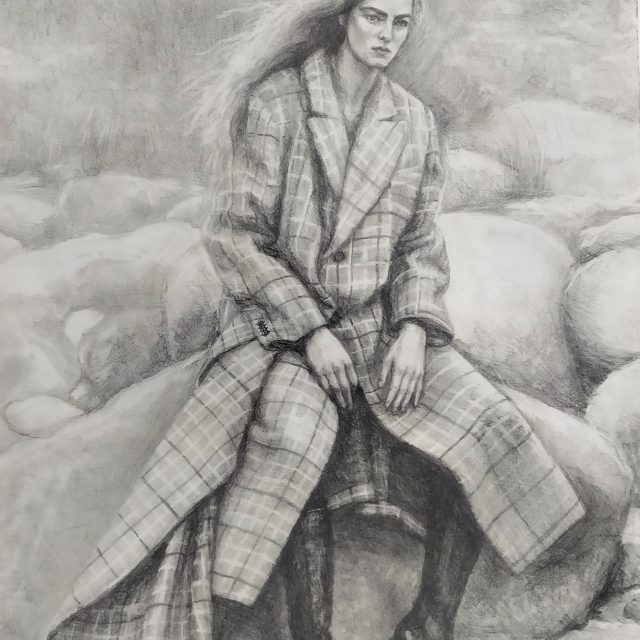 Sitting woman in a plaid coat