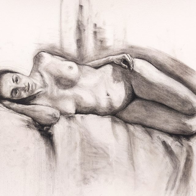 naked woman lying on the bed drawing
